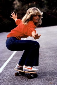Farrah Fawcett in flared jeans and some kind of button up sweater. (who knows?)
